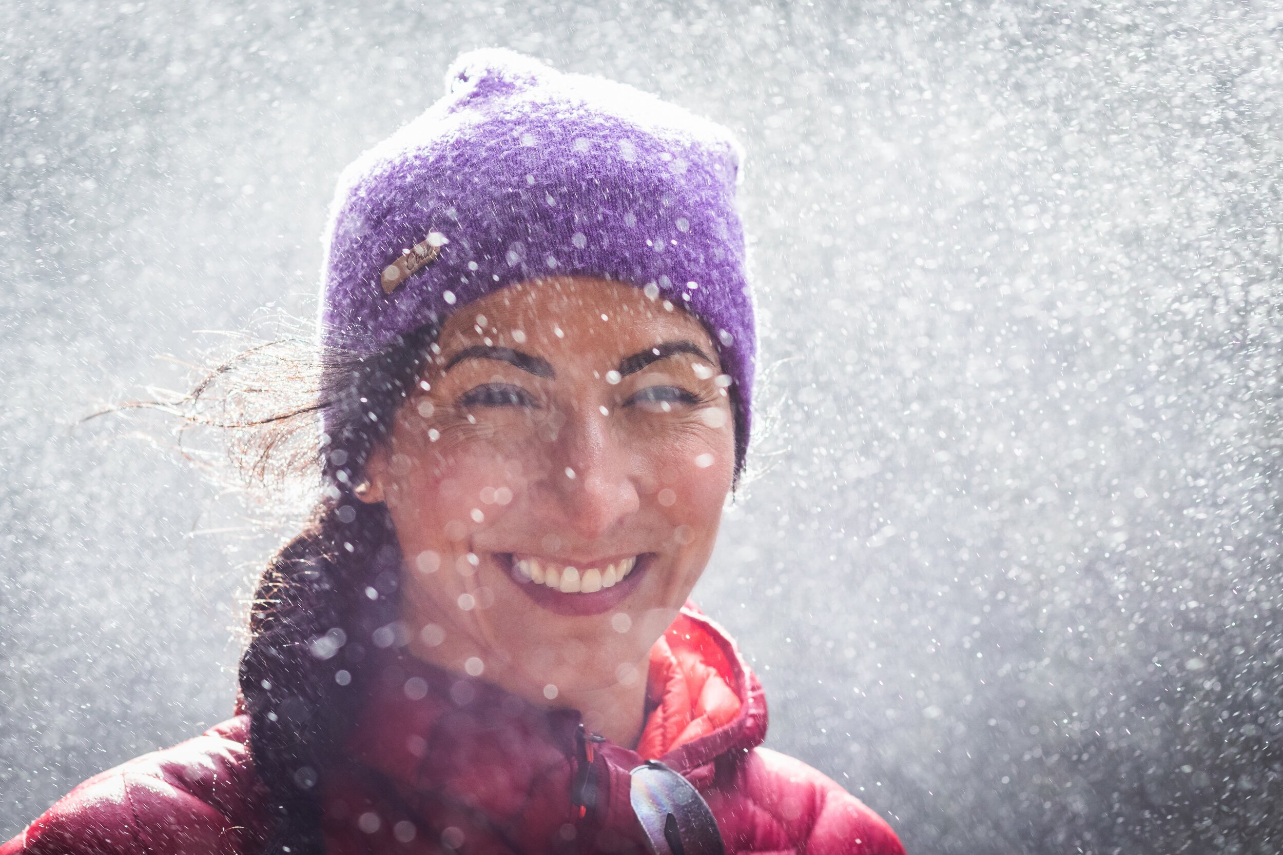 woman smiling with snow around her